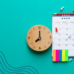 A calendar, clock and stationary on a teal background